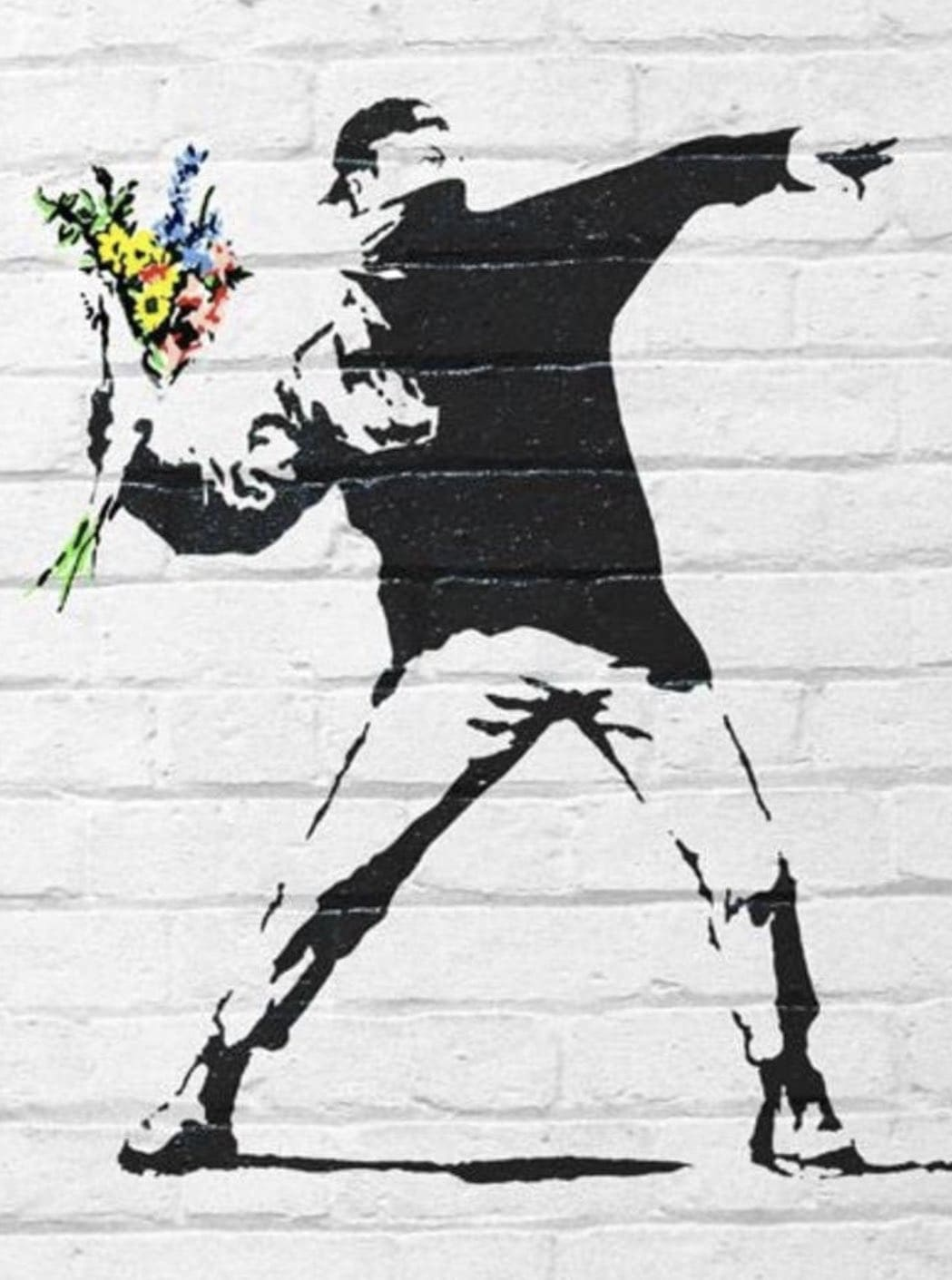 Man throwing flowers instead of bombs